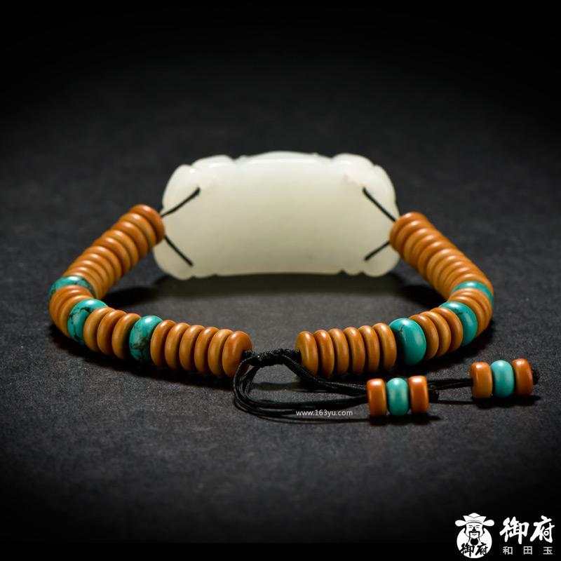 新疆和田玉黄皮白玉籽玉手牌 仿古兽面 34.2克